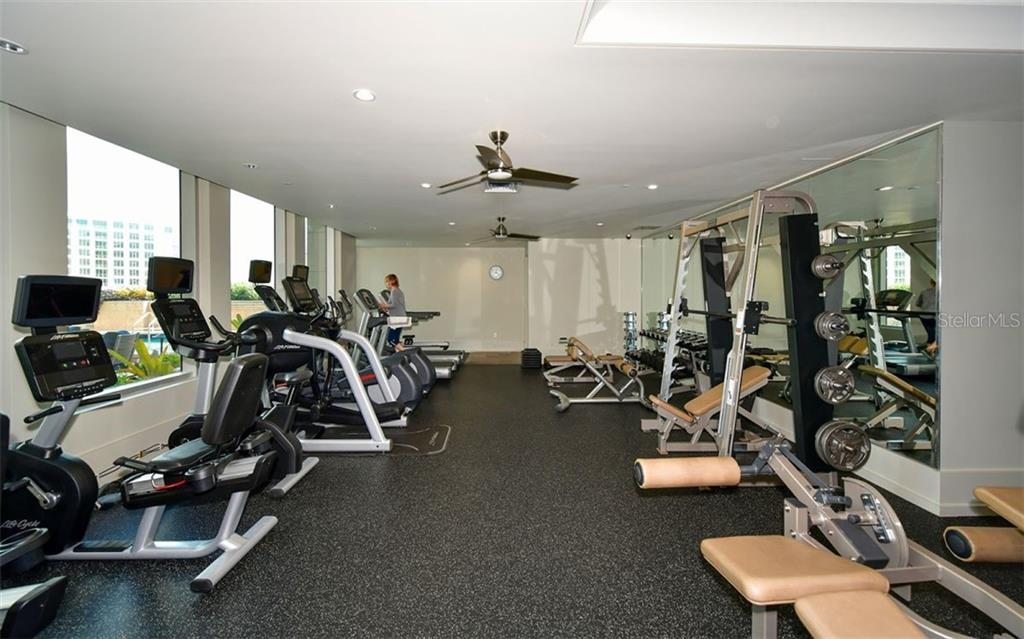 Fitness center overlooks the pool deck - Condo for sale at 1350 Main St #1601, Sarasota, FL 34236 - MLS Number is A4478753