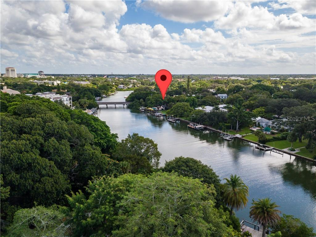 Located on the Hudson Bayou and across from Selby Gardens - Single Family Home for sale at 1595 Bay Point Dr, Sarasota, FL 34236 - MLS Number is A4479218