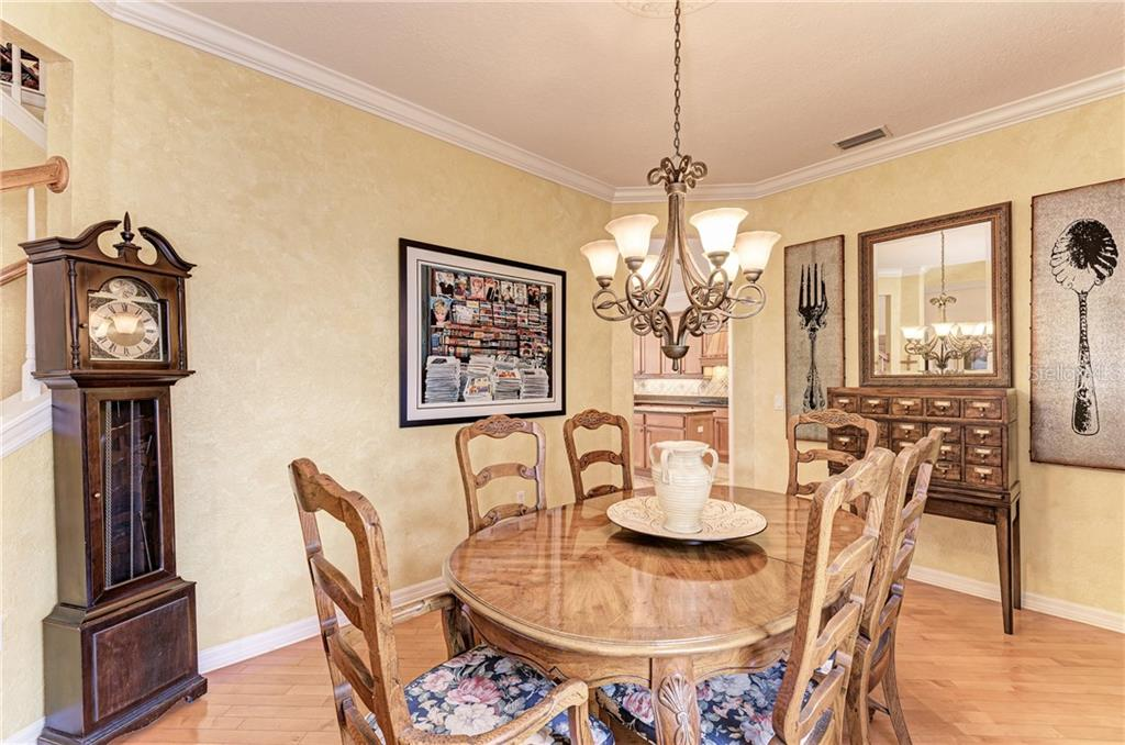 Formal dining room - Single Family Home for sale at 7118 68th Dr E, Bradenton, FL 34203 - MLS Number is A4480398