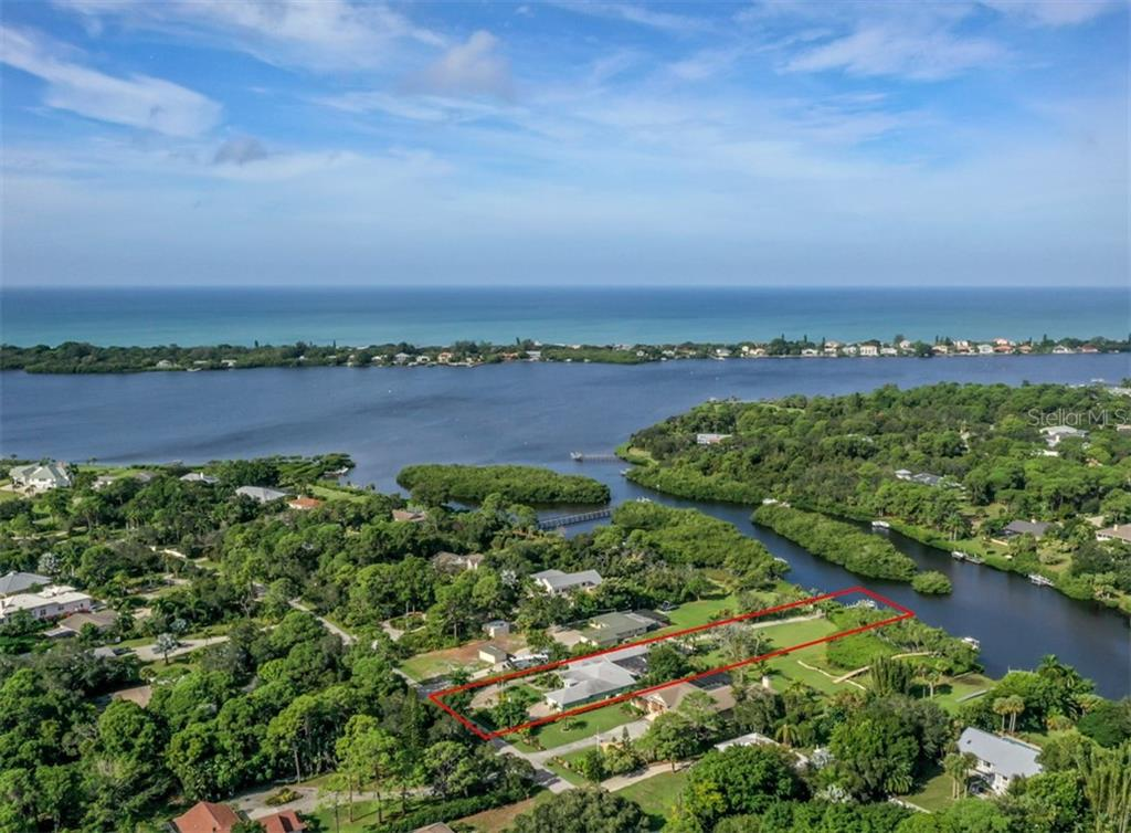 Aerial - Forked Creek leading to Lemon Bay -- Manasota Key and Gulf of Mexico -- Approx. 8 lots to Lemon Bay - Single Family Home for sale at 1395 Bayshore Dr, Englewood, FL 34223 - MLS Number is A4480508