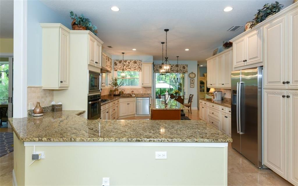 Full kitchen view! Creating those special meals for family and friends will be a breeze in this amazing kitchen! - Single Family Home for sale at 1603 Landfall Dr, Nokomis, FL 34275 - MLS Number is A4480987