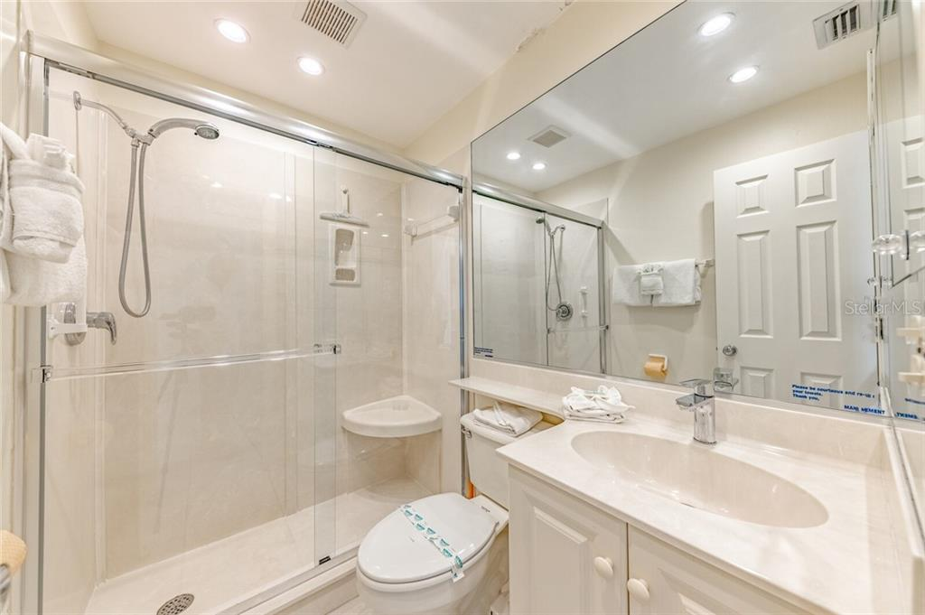 Guest Bath - Condo for sale at 5830 Midnight Pass Rd #303, Sarasota, FL 34242 - MLS Number is A4481917