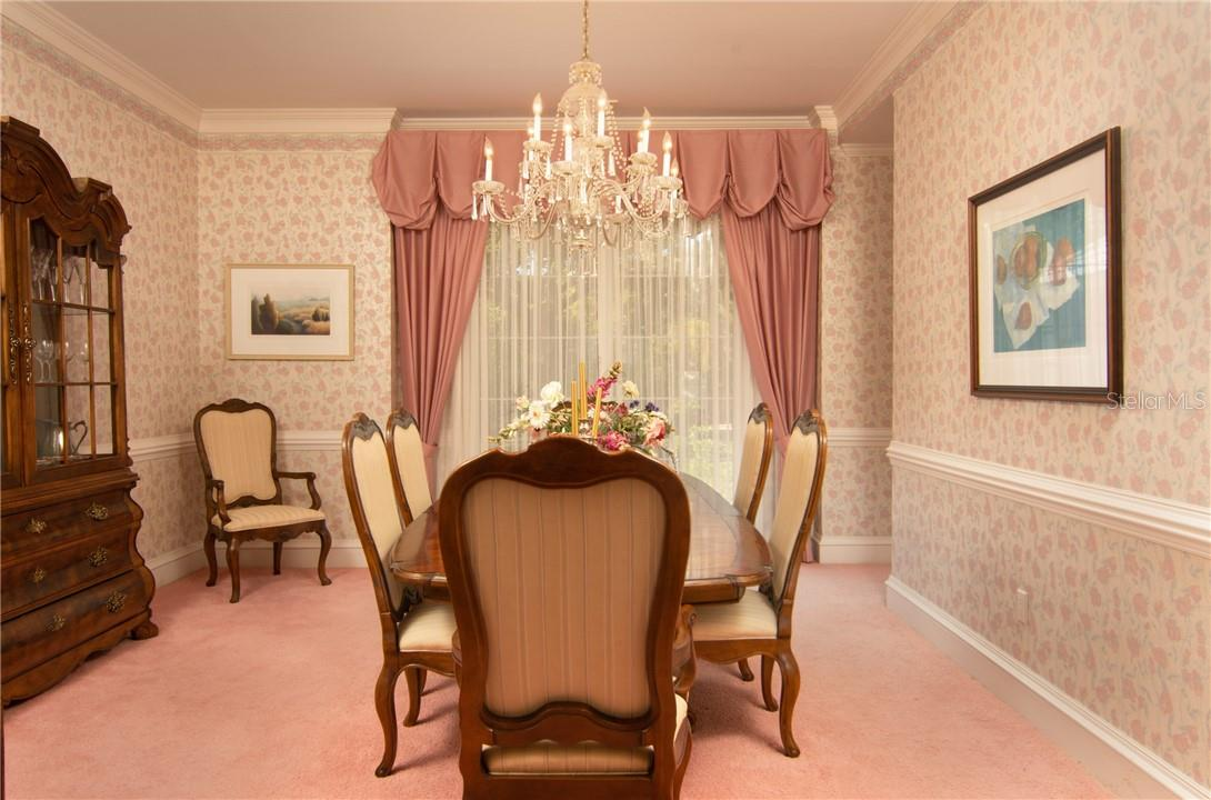 Formal dining room. - Single Family Home for sale at Address Withheld, Sarasota, FL 34242 - MLS Number is A4483403