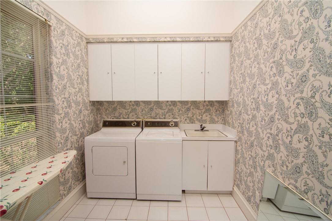 Large laundry room - Single Family Home for sale at Address Withheld, Sarasota, FL 34242 - MLS Number is A4483403