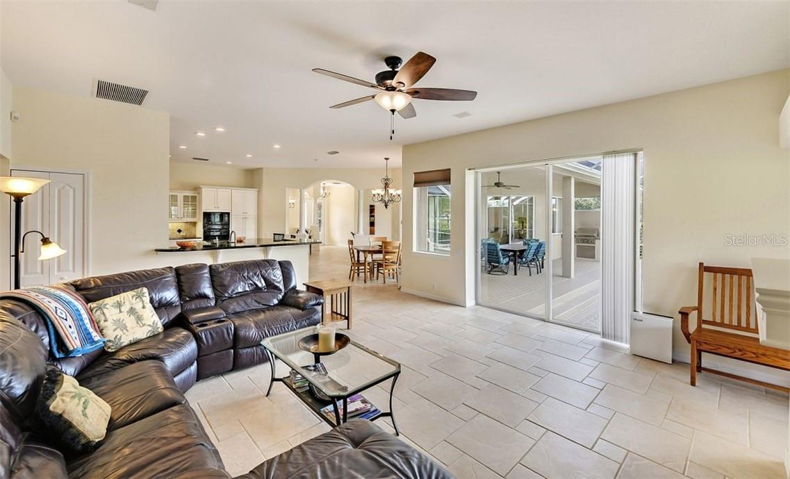 Family room with sliders to lanai - Single Family Home for sale at 7832 Panther Ridge Trl, Bradenton, FL 34202 - MLS Number is A4483837