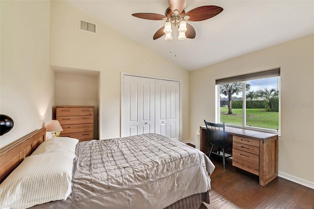 Freshly painted Guest bedroom with engineered wood flooring - Single Family Home for sale at 7832 Panther Ridge Trl, Bradenton, FL 34202 - MLS Number is A4483837