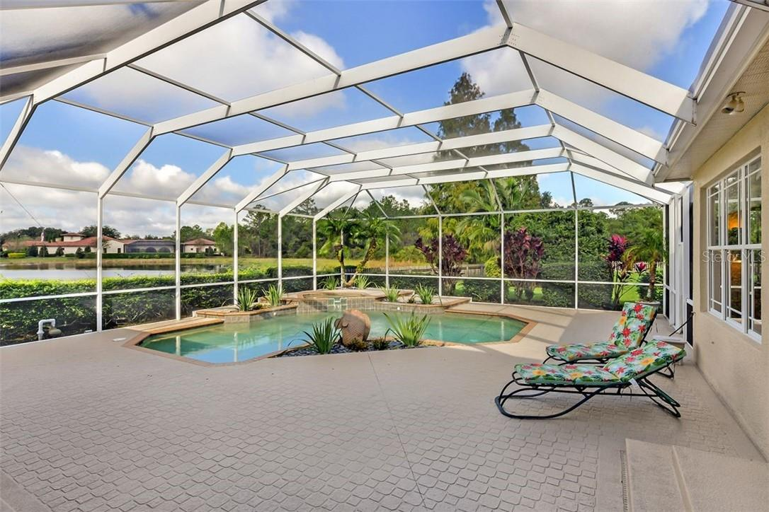 Huge lanai with gas heated pool and spa. All cage bolts and 2 screen doors are brand new. Screens replaced in 2018. - Single Family Home for sale at 7832 Panther Ridge Trl, Bradenton, FL 34202 - MLS Number is A4483837