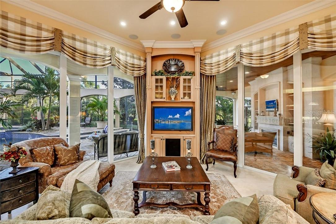 Walls of windows & accordion sliders to open you to the outdoors in minutes. - Single Family Home for sale at 8263 Archers Ct, Sarasota, FL 34240 - MLS Number is A4483993