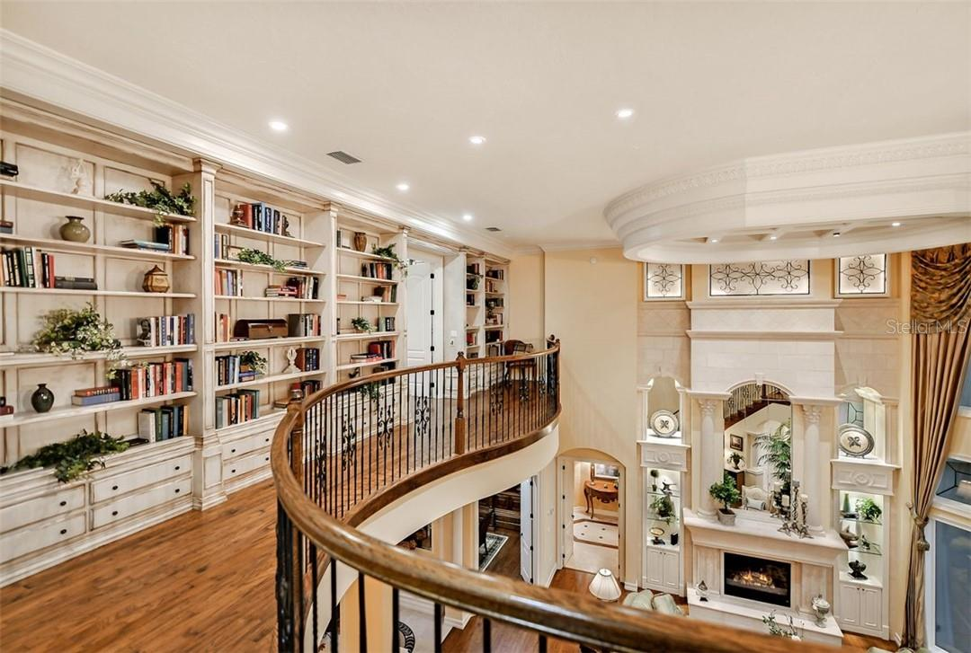 The walls of books in the Library , it feels so massive with those high ceilings - Single Family Home for sale at 8263 Archers Ct, Sarasota, FL 34240 - MLS Number is A4483993