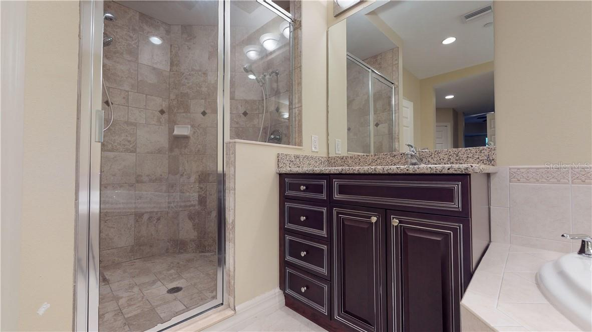 Primary bathroom with walk-in tiled shower - Condo for sale at 5591 Cannes Cir #506, Sarasota, FL 34231 - MLS Number is A4484243