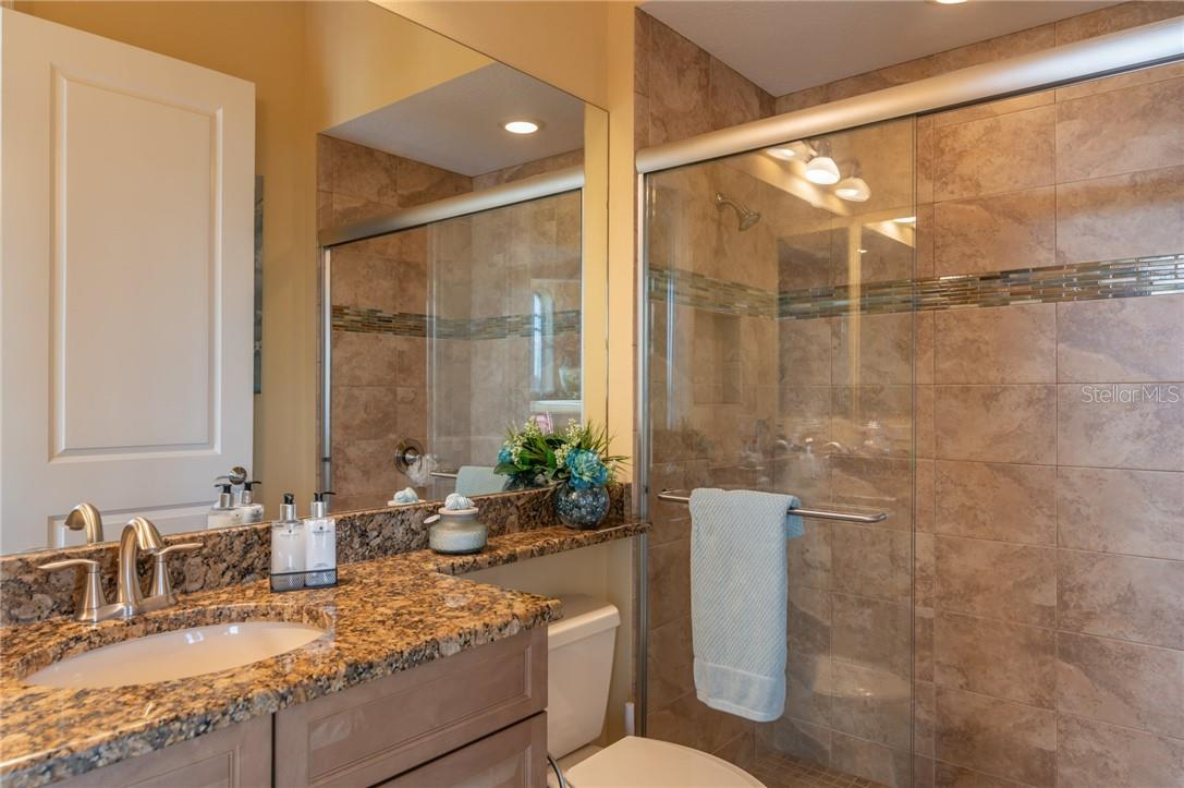 The Pool Bathroom is off of the Veranda, giving wet access to and from the pool and lanai. - Single Family Home for sale at 11720 Rive Isle Run, Parrish, FL 34219 - MLS Number is A4486302