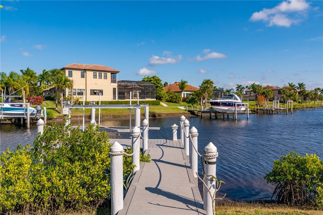 Bring your boat ... this home is ready for family boating excursions on the river or on the gulf.  It features a dock with a 10,000 pound boat lift.  The dock has power and water service. - Single Family Home for sale at 11720 Rive Isle Run, Parrish, FL 34219 - MLS Number is A4486302