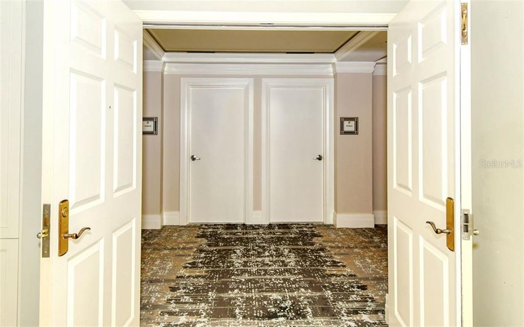Double doors open to the hallway - Condo for sale at 50 Central Ave #14b, Sarasota, FL 34236 - MLS Number is A4487974