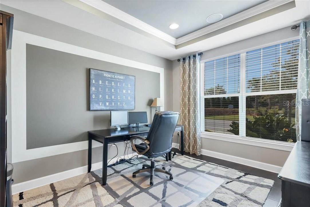 Front den/office/bonus room with tray veiling nd crown molding and accent wall. French doors from the Foyer for privacy. - Single Family Home for sale at 11713 Blue Hill Trl, Bradenton, FL 34211 - MLS Number is A4490622