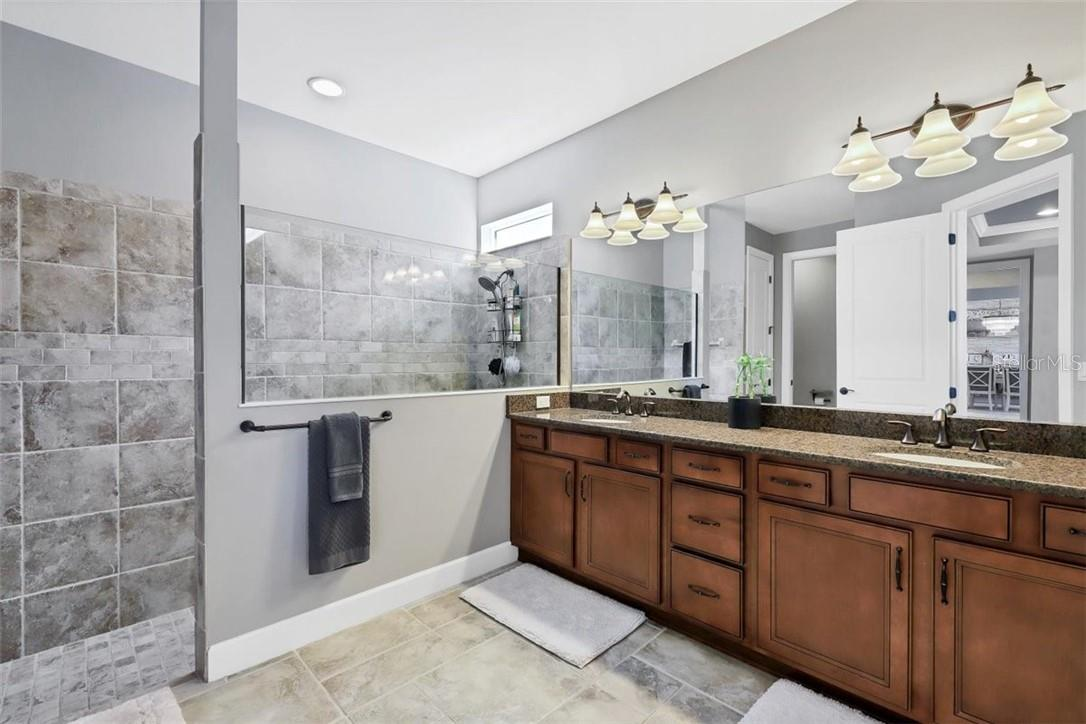 Luxurious Owner's bath. - Single Family Home for sale at 11713 Blue Hill Trl, Bradenton, FL 34211 - MLS Number is A4490622