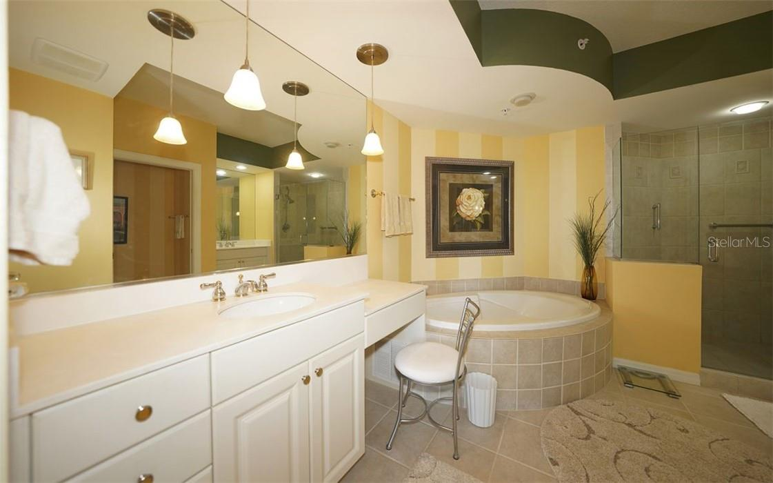 Master bath with walk in shower, double vanities and soaking tub! - Condo for sale at 409 N Point Rd #402, Osprey, FL 34229 - MLS Number is A4491620