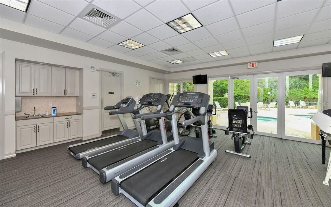 Fitness center for Meridian residents, steps from your door - Condo for sale at 409 N Point Rd #402, Osprey, FL 34229 - MLS Number is A4491620