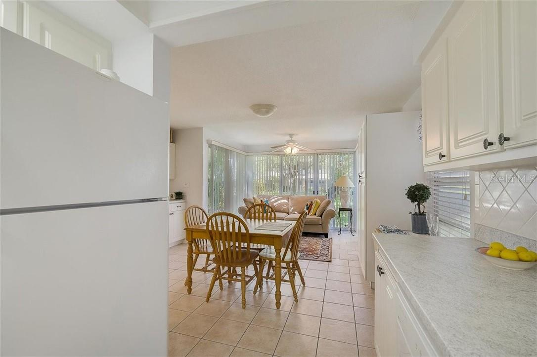 577 Sutton Place Longboat Key Florida 34228 | Kitchen Looking Out to Dining Room and Florida Room - Condo for sale at 577 Sutton Pl #T-25, Longboat Key, FL 34228 - MLS Number is A4492432