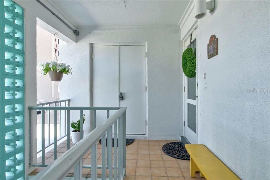 Foyer and Hallway - Impact Door - Condo for sale at 5400 Gulf Dr #44, Holmes Beach, FL 34217 - MLS Number is A4493017