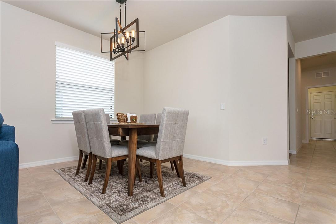 Full sized dining room give you lots of entertain options - Villa for sale at 13883 Botteri St, Venice, FL 34293 - MLS Number is A4493523
