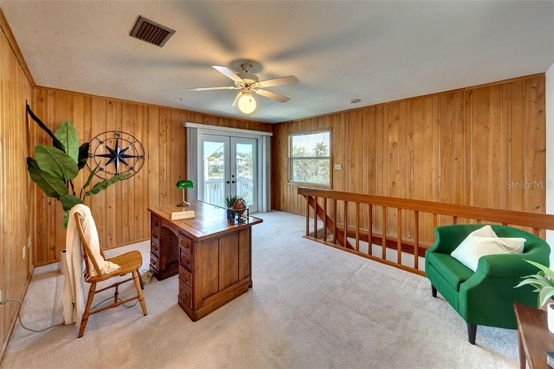 Office / flex space adjoining Owner en-suite with balcony and walkway over the pool and water views - Single Family Home for sale at 1908 72nd St Nw, Bradenton, FL 34209 - MLS Number is A4495621