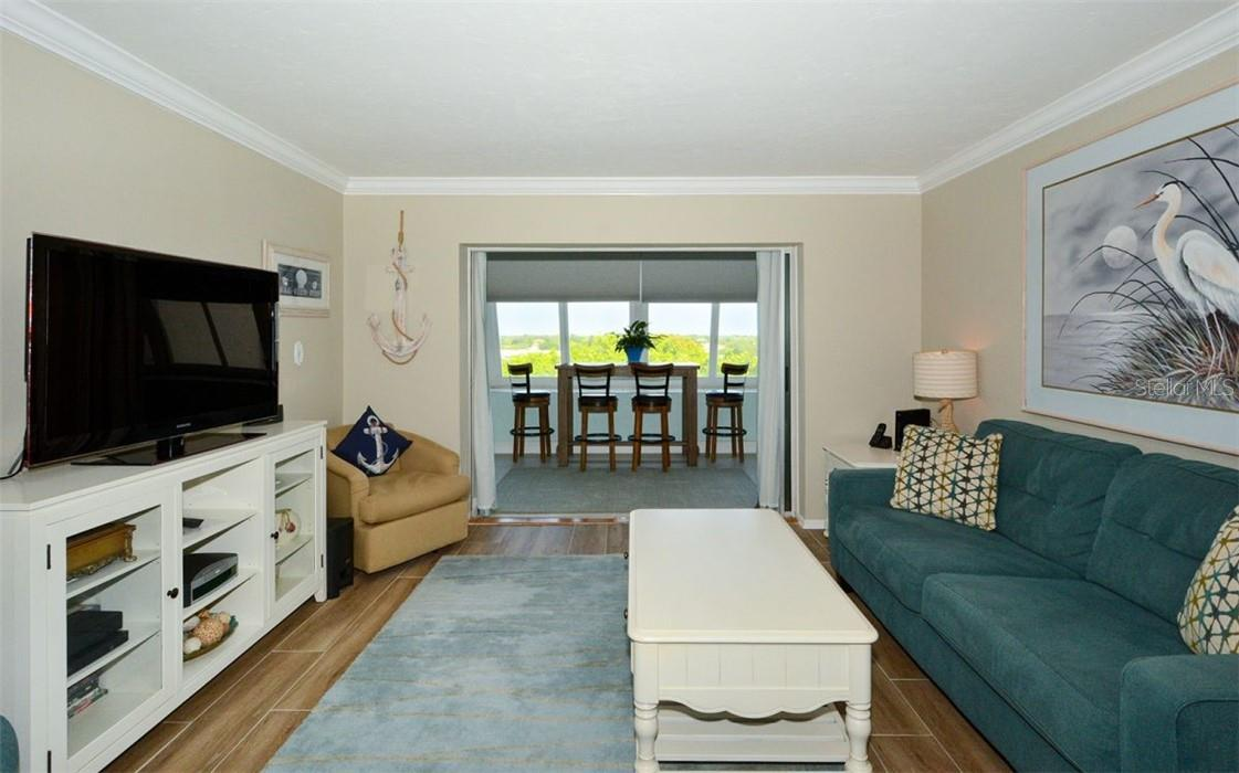 Living Room looking into the lanai and view - Condo for sale at 1200 E Peppertree Ln #602, Sarasota, FL 34242 - MLS Number is A4495963