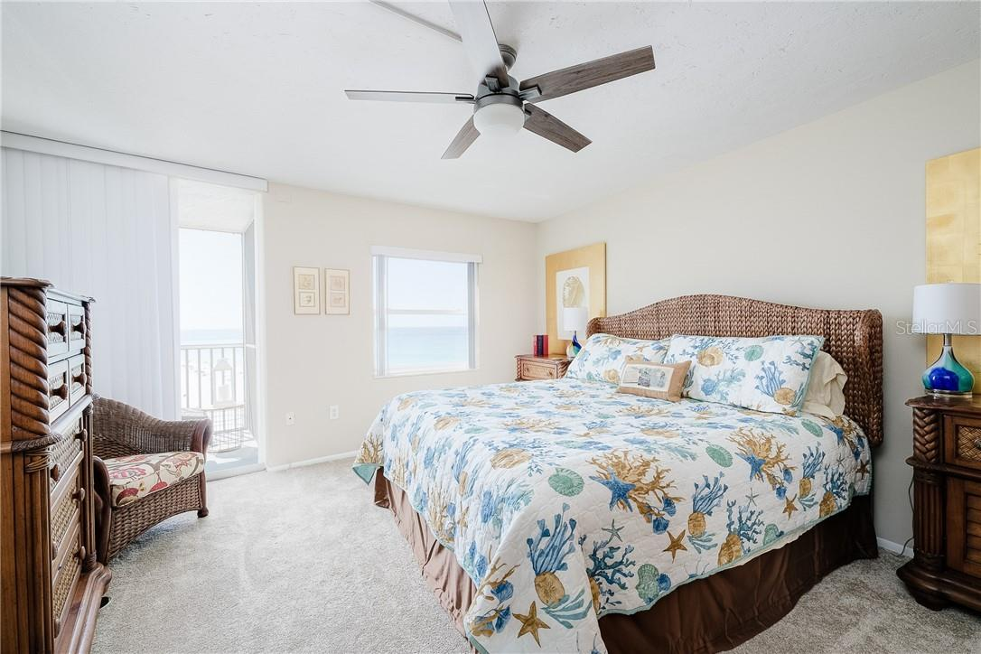 Master Bedroom with Sliders to Balcony - Condo for sale at 6300 Midnight Pass Rd #701, Sarasota, FL 34242 - MLS Number is A4496847