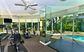 Exercise room with view to sun deck and swimming pool - Condo for sale at 500 S Palm Ave #41, Sarasota, FL 34236 - MLS Number is A4144835