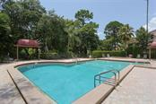 Community swimming pool - Condo for sale at 7631 Fairway Woods Dr #601, Sarasota, FL 34238 - MLS Number is A4168292