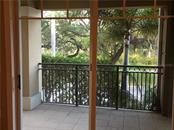 Covered porch area is made private with landscaping. View is over to Pioneer Park on the north side of 11th Street. - Condo for sale at 1064 N Tamiami Trl #1131, Sarasota, FL 34236 - MLS Number is A4174927