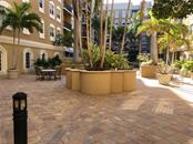 Broadway Promenade has an inner courtyard with tables and chairs around the fountain. - Condo for sale at 1064 N Tamiami Trl #1131, Sarasota, FL 34236 - MLS Number is A4174927
