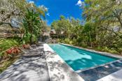 Single Family Home for sale at 4637 Hidden Forest Dr, Sarasota, FL 34235 - MLS Number is A4179954