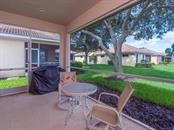 Covered, screened lanai - Single Family Home for sale at 4294 Reflections Pkwy, Sarasota, FL 34233 - MLS Number is A4185695