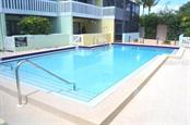 steps away to the community pool - Condo for sale at 1749 Dawn St S #303, Sarasota, FL 34231 - MLS Number is A4186116
