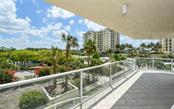 Terrace wraps around corner of unit - Condo for sale at 1800 Benjamin Franklin Dr #a202, Sarasota, FL 34236 - MLS Number is A4187131