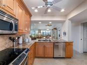 Kitchen - Condo for sale at 6236 Midnight Pass Rd #406, Sarasota, FL 34242 - MLS Number is A4188093