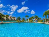 Swimming pool and sun deck - Condo for sale at 6236 Midnight Pass Rd #406, Sarasota, FL 34242 - MLS Number is A4188093