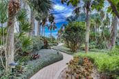 lush landscaping with walk to beach - Condo for sale at 5880 Midnight Pass Rd #610, Sarasota, FL 34242 - MLS Number is A4204670