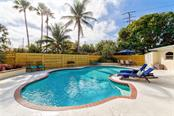 The lush landscaping surrounding the pool area provides your own private oasis! - Single Family Home for sale at 501 70th St, Holmes Beach, FL 34217 - MLS Number is A4205799