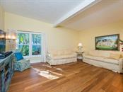 Family room - Single Family Home for sale at 8101 Midnight Pass Rd, Sarasota, FL 34242 - MLS Number is A4206718