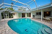 Screened pool with pavers - Single Family Home for sale at 600 Wild Turkey Ln, Sarasota, FL 34236 - MLS Number is A4210585