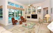 Family room - Single Family Home for sale at 402 Trenwick Ln, Venice, FL 34293 - MLS Number is A4214615