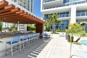 Grilling area on the pool deck - Condo for sale at 1155 N Gulfstream Ave #1504, Sarasota, FL 34236 - MLS Number is A4215032