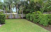 Enjoy playtime outdoors in the private fenced backyard. - Single Family Home for sale at 1670 Bay View Dr, Sarasota, FL 34239 - MLS Number is A4400079