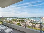 Open lanai featuring some of the best views in Sarasota. - Condo for sale at 1301 Main St #1001, Sarasota, FL 34236 - MLS Number is A4402790