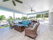 The perfect place for morning coffee, enjoying the views or outdoor entertaining - Single Family Home for sale at 7643 Cove Ter, Sarasota, FL 34231 - MLS Number is A4403215