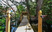 Private Dock leading to House - Single Family Home for sale at 1238 Sea Plume Way, Sarasota, FL 34242 - MLS Number is A4408272