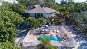 Overview of home, pool & trees - Single Family Home for sale at 6661 Gulf Of Mexico Dr, Longboat Key, FL 34228 - MLS Number is A4410988
