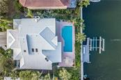 Aerial view of home and dock - Single Family Home for sale at 4963 Oxford Dr, Sarasota, FL 34242 - MLS Number is A4417783