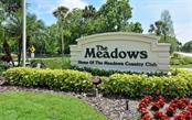 Entrance to The Meadows from 17th Street - Condo for sale at 4576 Longwater Chase #59, Sarasota, FL 34235 - MLS Number is A4418168